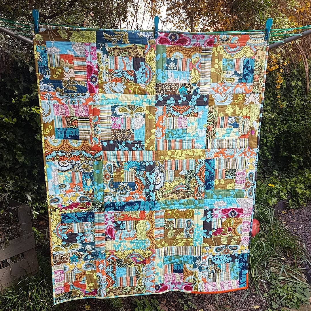 Log cabin spring lap quilt made with Amy Butler Belle jelly roll